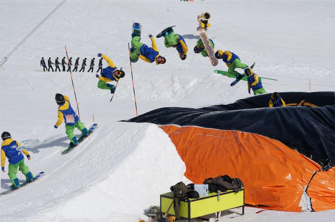 A group of people flying kites in the snow