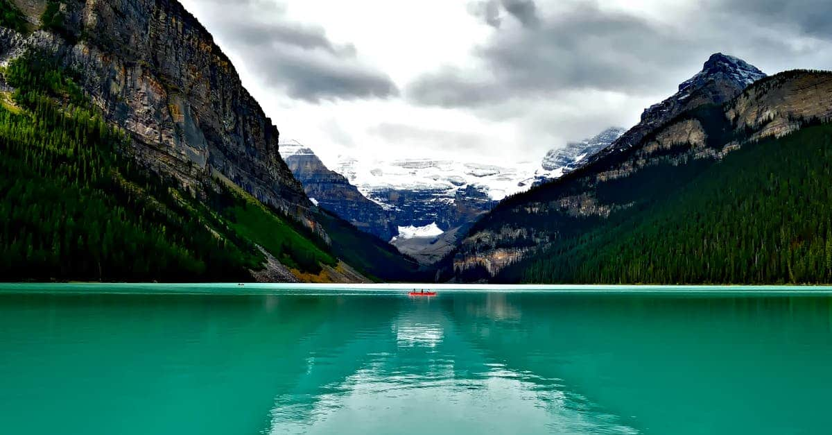 A large body of water with Lake Louise in the background